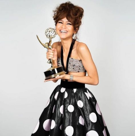 Zendaya posing with her Emmy trophy after receiving an award for Best Lead Actress in a Drama Series.  Photo from bbc.news