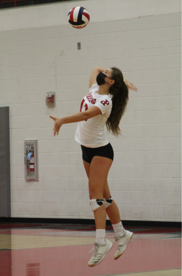 Dreisbach mid-serve during the PHS home opener. Image Source: Par Key Yearbook